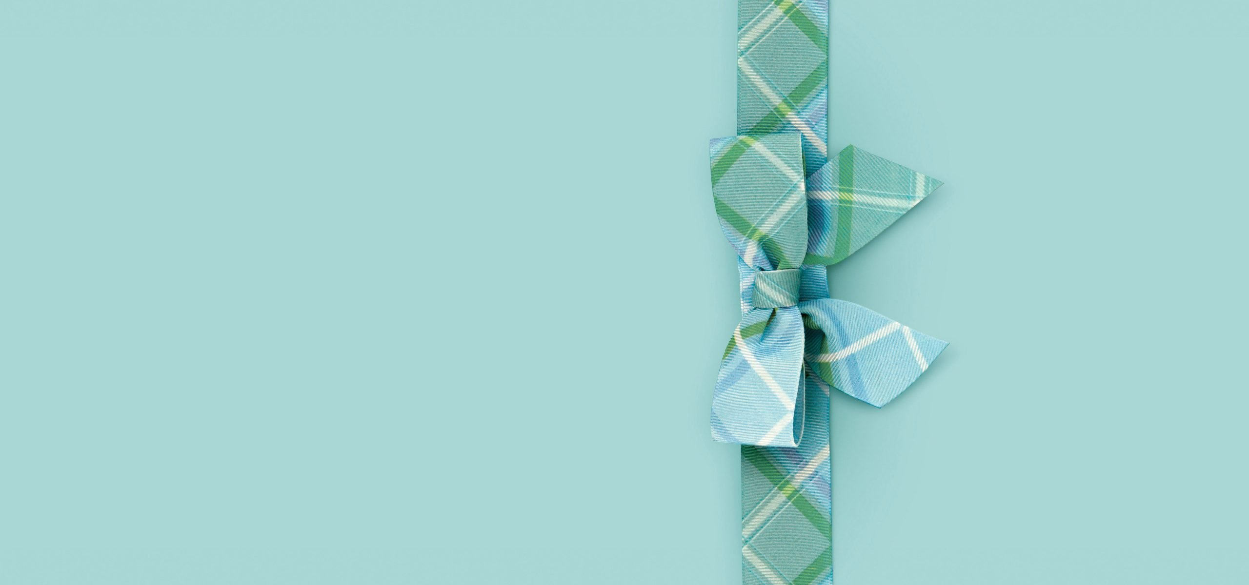 Liz Earle Packaging Design, tartan ribbon on blue background
